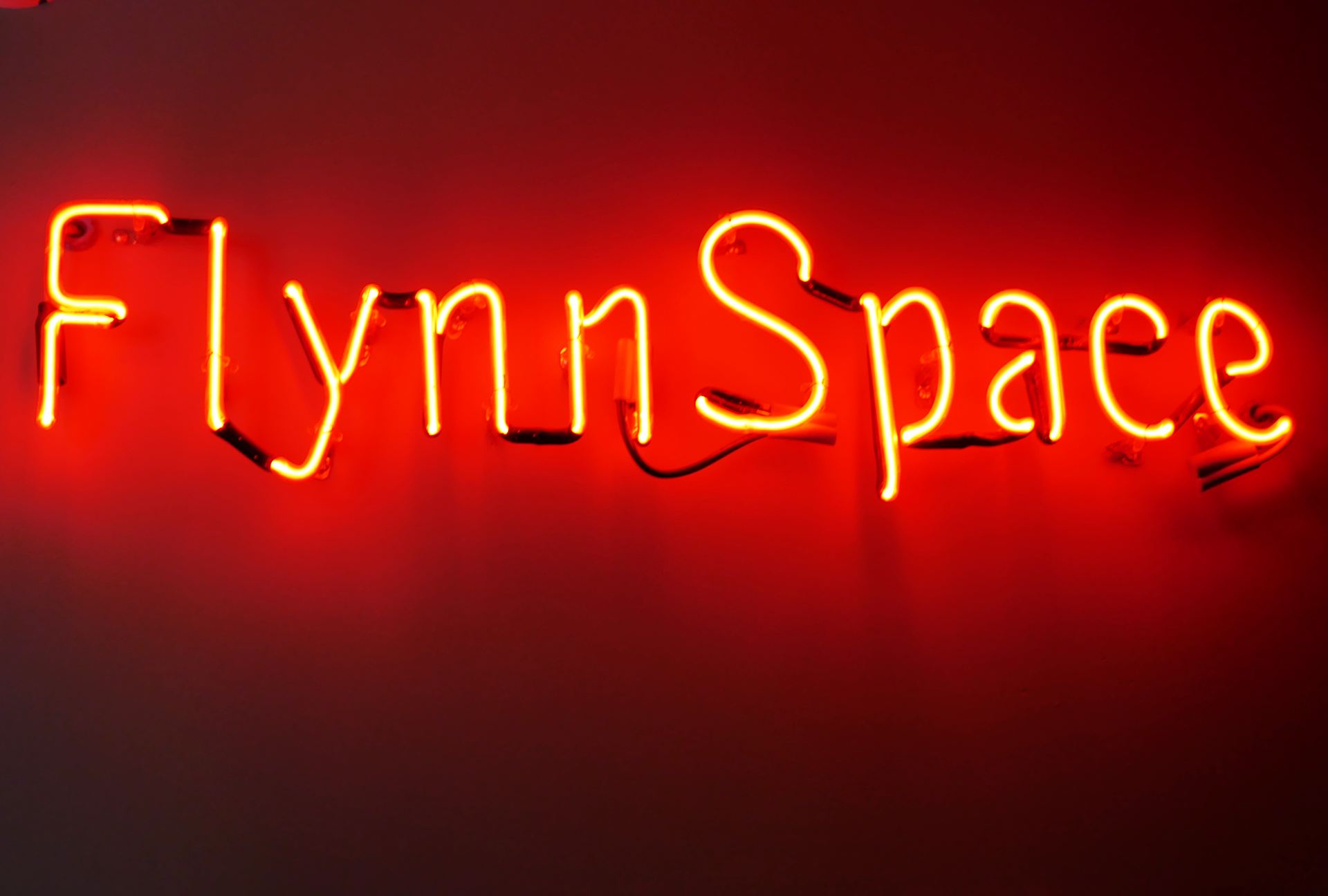Flynn Space neon sign.